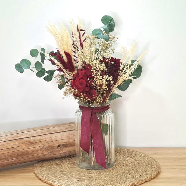 centro de cristal con flores preservadas