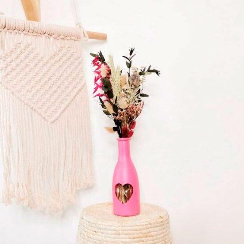 jarrón fucsia de flores Liebe