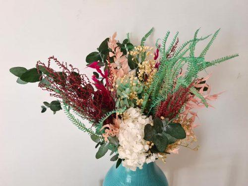 detalle de jarrón de flores Sanoa